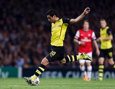 Borussia Dortmund midfielder Henrikh Mkhitaryan scores the opening goal during the Champions League match against Arsenal in London on Octob...