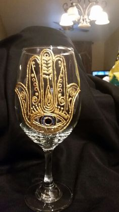 Hamsa hand painted wine glass