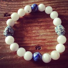 """Site is back up and running! Check out this new Quartz, Lapis Lazuli, and Ceramic Buddha head wrist mala!  http://theeasiersofterway.com/shop  Use coupon code """"newsite"""" for free shipping in the US!  #mala #malabeads #freeshipping #quartz #lapis #lapislazuli #buddha #buddhism"""
