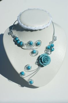 Turquoise flower open necklace made with metal par BijouxLibellule, $30.00