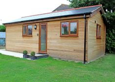 Recently completed Granny Annexe garden home built in Southampton, UK. A pitched roof annexe with Red Cedar timber exterior cladding. Designed and constructed by Granny Annexe www.grannyannexe.com