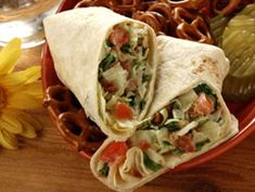 """BLT Rollups - If you'd prefer, use light mayonnaise and whole-wheat tortillas and, instead of bacon bits, chop a quarter pound of deli turkey to mix in and create a """"TLT"""" burrito. Click to see recipe."""