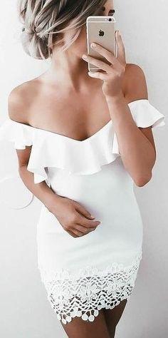 white off shoulders dress. ruffle detail. crochet trim. bodycon mini.