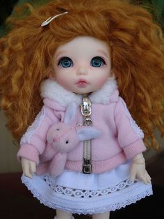 I think she's adorable with her red curly hair and her bunny... :)