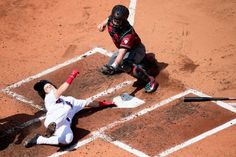 You're out:    Andrew Benintendi of the Boston Red Sox, left, is tagged out by catcher Tuffy Gosewisch of the Arizona Diamondbacks in the second inning at Fenway Park in Boston on Aug. 14.