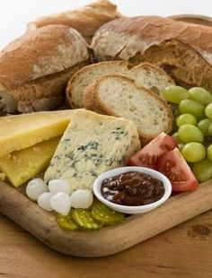 grapes, tomatoes, chutney, pickles, cheese, bread.