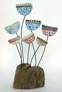 Jazz Meadow by Shirley Vauvelle in Sculpture Archive, Sculpture using Earthenware and driftwood. Ceramic Flowers, Clay Flowers, Polymer Clay Projects, Clay Crafts, Paperclay, Driftwood Art, Ceramic Clay, Clay Art, Garden Art