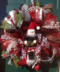 SnowGirl Wreath. Check out her plaid skirt, green mittens and Santa hat! She can be proudly displayed all winter. Please visit my FB page for more of my designs: Ms. Kay's a-DOORable Designs.