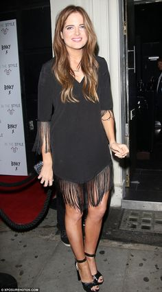 Her hard work paid off: The Made In Chelsea star looked pleased with herself as she posed in a chic LBD from her new collection with In The Style