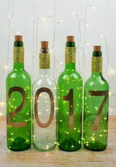 These simple DIY wine bottle light are the perfect quick New Year craft. They are a great way to recycle used wine bottles and also decorate your home. Wine Bottle Art, Lighted Wine Bottles, Bottle Lights, Wine Bottle Crafts, Mason Jar Crafts, New Year's Crafts, Easy Crafts, Easy Diy, Simple Diy