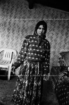 Kalderash Roma girl in her one room home, in the Roma camp of Sintesti, near Bucharest.