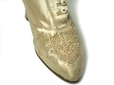 Shoe-Icons / Shoes / Ivory satin high side buttoned boots, decorated with clear beading on the vamp.