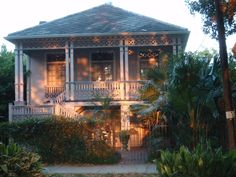 "Another lavender house at the ""magic hour"" just before sundown. This one faces Audubon Park, so its address is Exposition Boulevard, named after the 1884 World's Fair and Cotton Exposition held on the grounds of what is now the park. New Orleans Architecture, Audubon Park, Magic Hour, World's Fair, Gazebo, Lavender, Cottage, Outdoor Structures, Kiosk"