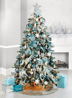 But if you truly want to stand out, we'd suggest you go for a blue Christmas tree this year. we've gathered a list of blue Christmas tree decoration ideas. Blue Christmas Tree Decorations, Turquoise Christmas, Christmas Tree Design, Beautiful Christmas Trees, Elegant Christmas, Noel Christmas, Rustic Christmas, Teal Christmas Tree, Christmas Ideas