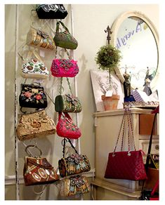 DIY Purse Organizer : upcycle an iron gate (can paint if wanted) and use it to hang purses... very chic!