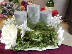 Christmas flower arrangement made with paper flowers and preserved greens