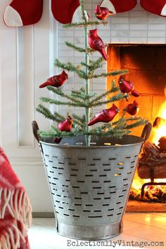 Vintage olive bucket with Christmas tree - love the red cardinal ornaments eclecticallyvintage.com