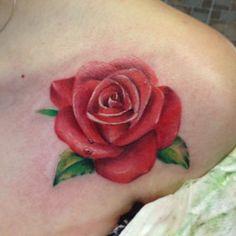 Soft, Feminine Rose Tattoo.