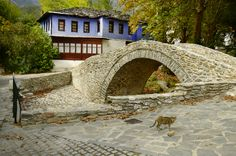Greece, footbridge over river bed and colorful home in mountain village Moustheni Mountain Village, Image Photography, Birds In Flight, House Colors, Royalty Free Stock Photos, Patio, Mansions, House Styles, Outdoor Decor