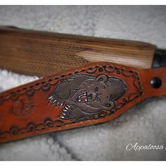 A custom leather gun sling - an upgraded version of our grizzly bear rifle sling with a stitched border and foam padding. www.facebook.com/appaloosaleather