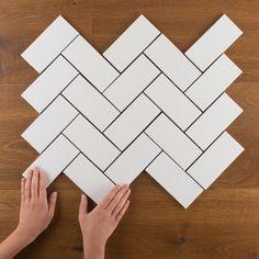 Try classic 3x6 subway tile in a herringbone pattern.