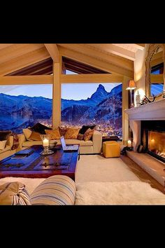 Cozy mountain home. Warm white lighting creates a contrast with the view.