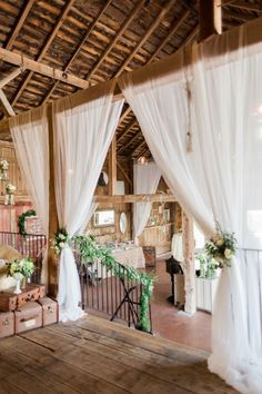 White details keep the decor at this country barn wedding feeling light and airy.