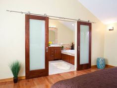 Sliding doors are a chic way to open up a space, but can also provide privacy when needed.