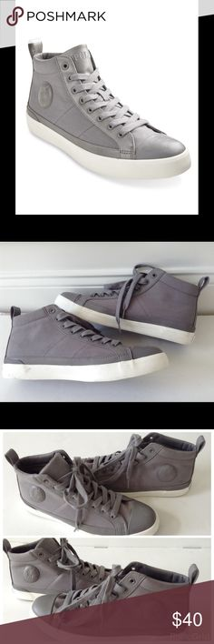 POLO RALPH LAUREN GRAY CANVAS YOUNG MEN SNEAKERS POLO RALPH LAUREN GREY CLARKE CANVAS HI TOP SNEAKERS YOUNG MEN, Kick back and enjoy the functional and stylish Authentic Canvas Clarke sneaker Round toe.  With a classic high-top silhouette and sleek leather trim, this canvas textile sneaker will become a year-round go-to. A tonal patch with the debossed pony adds a subtle, signature touch. Embroidered tongue signature, padded collar and canvas insole, leather back pull-tab at the ankle for…