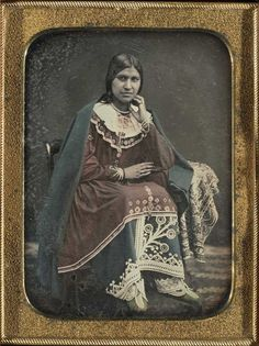 Caroline Parker (seneca) in 1849 who by the age of 19 was already recognized as a highly skilled artist. She is wearing an outfit that she created herself. Her blue woolen broadcloth skirt is decorated with iroquois symbols. Native American Women, Native American Fashion, Native American History, Native American Indians, Seneca Indians, Iroquois, Native Indian, Women In History, First Nations