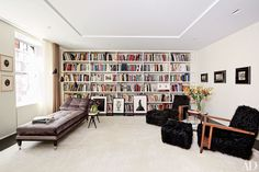 In the New York home of art dealer Amy Gold and auction broker Brett Gorvy, D'Apostrophe Design employed a wall of shelving to house the power couple's expansive collection of monographs.