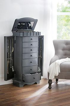 Tuck your favorite accessories into their very own hideaways with Home Decorators Collection Bronwyn Jewelry Armoire in Graphic Charcoal. Mirror Jewelry Armoire, Jewelry Chest, Jewelry Cabinet, Jewelry Box, Silver Jewelry, Nice Jewelry, Jewelry Boards, Jewelry Holder, Silver Bracelets