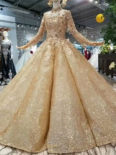 Buy Ball Gown Gold Long Sleeves Lace Appliques Sequins Open Back Beads Quinceanera Dresses uk in uk.Shop our beautiful collection of unique and convertible long Prom dresses from Kikiprom,offers long bridesmaid dresses for women online. Long Bridesmaid Dresses, Prom Dresses, Wedding Dresses, Elegant Dresses, Beautiful Dresses, Robes Quinceanera, Robes D'occasion, Long Sleeve Wedding, Occasion Dresses