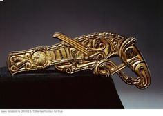 Bridle mount in the form of a winged dragon. Country of Origin: Sweden. Culture: Viking. Date/Period: 8th C. Material Size: Gilt-bronze. Credit Line: Werner Forman Archive/ Statens Historiska Museum, Stockholm . Location: 18.