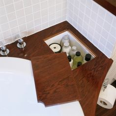 Low on Bathroom storage? Hide it within your countertop. Great Hidden Storage Ideas We Love at Design Connection, Inc. | Kansas City Interior Designer
