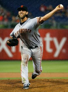 San Francisco Giants starting pitcher Madison Bumgarner pitches in the rain during the fifth inning of a baseball game against the Philadelphia Phillies, Wednesday, July 23, 2014, in Philadelphia. (AP Photo/Chris Szagola)