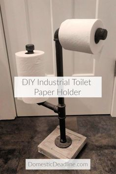 Learn how to use industrial gas pipe to make a toilet paper holder to dispense and hold extra rolls. Perfect for industrial farmhouse decor! DomesticDeadline.com