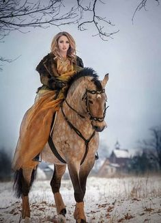 Horse and lady rider. This horse is stunning.