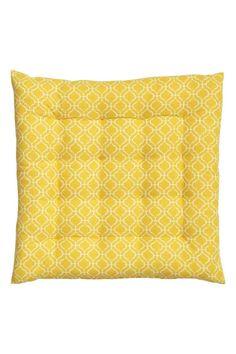 Galette de chaise à motif: Galette de chaise en coton tissé avec motif imprimé. Épaisseur 4 cm. Garnissage polyester.