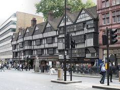 Staple Inn, Holborn Bars, City of London. The only surviving 16th century Elizabethan street scape in the City, restored in Victorian times. See in autumn dusk with the gas lights. Surprise courtyard garden through the archway beside the hall.