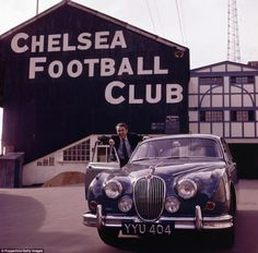 Jimmy Greaves poses with his Jaguar Mark 2 car outside Stamford Bridge in England international striker Greaves was a Tottenham player at this time, but he started his career by coming through the ranks at Chelsea, playing 169 times for them Best Football Team, Chelsea Football, Football Stadiums, College Football, Club Chelsea, Chelsea Fans, Stamford Bridge Chelsea, Jimmy Greaves, Bobby Charlton
