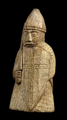 The Lewis Chessmen, carved from walrus ivory and whales teeth (Belonging to a group of 78 pieces found at one site on the Isle of Lewis (Camas Uig) in the Outer Hebrides of Scotland, 1831); 12th century, probably made by Viking craftsmen originating in Trondheim, Norway.