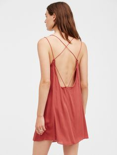 Awakening Slip | Lightweight, semi-sheer slip with crisscross back detail and pretty crochet accents. Small front slits for a subtle femme feel.
