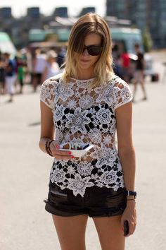 white lace top over black shorts.