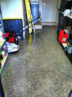 Sundek Garage Floor Epoxy Coating system.  Great long term investment on any garage floor surface.  www.sundek.com