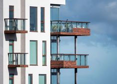 The Musical Neighborhood in Aalborg with balconies in UHPC. Supported by brackets and columns and covered with thousands of 14 mm thin brick shells. Thin Brick, Aalborg, Balconies, Columns, Concrete, The Neighbourhood, Musicals, Shells, Cover