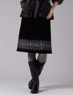 Flippy Cord Skirt $98.00 WG412 Outer 100% cotton Lining 100% polyester Machine washable Flattering swishy shape Sits at natural waist Length finishes at knee Concealed side zip Ribbon detailing Imported