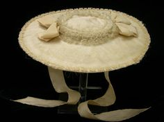 Straw hat (Bergère), England, 1760-1785. Creamy-white silk forming the covering and lining over a natural straw and paper foundation. Hat styled with broad brim and flat crown.