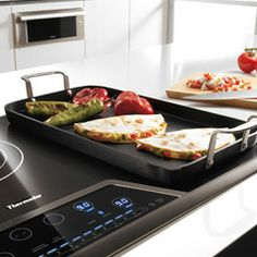 """Masterpiece™ Deluxe 36"""" Electric Cooktop with Touch Control and Bridge Element CET366FS"""
