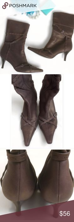 """Chocolate copper heeled boots Fabulous condition. Medium Chocolate slight copper shimmer color. Strappy Belt design. Sleek pointy toe. Inside zipper Midi-boots. 3"""" heel. """"Trail"""" Made in Brazil. Only worn 1 time. Bundle for a fantastic discount. Also open to offers. Carlos Santana Shoes Heeled Boots"""